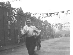 A celebration in Riverway - the now disappeared bit of road which ran between The Pilot pub and the river on the Greenwich peninsula