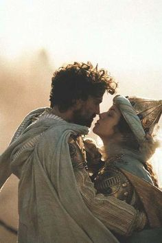 "Dougray Scott as Sultan Shahryar and Mili Avital as Queen Scheherazade from the television miniseries, ""Arabian Nights"" (2000)"