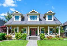This suburban house has a symmetrical front facade that looks balanced and harmonious.