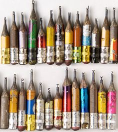 All 26 letters of the alphabet carved into the tips of pencils.  How?  How????