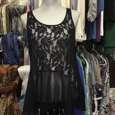 Black lace tank Beautiful great condition lace top with sheer flowing bottom. Zipper top back. love on a hanger Tops Camisoles
