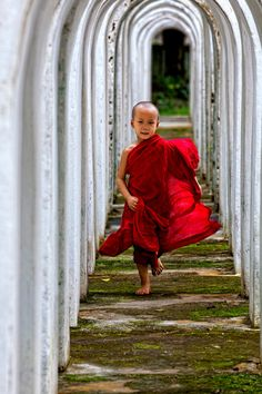 "smithsonianmag: "" Photo of the Day: A young monk running Photo by: Ye Tun (Yangon, Myanmar); Bago Town, Myanmar """