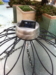 Our Garden Path: Hanging Chandelier from Wire Baskets. - Our Garden Path: Hanging Chandelier from Wire Baskets. Solar Chandelier, Outdoor Chandelier, Outdoor Lighting, Lighting Ideas, Plastic Chandelier, Chandelier Planter, Solar Lamp, Chandeliers, Solar Light Crafts