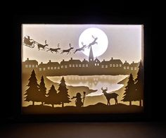 Find out how to make an amazing shadow box with light and a paper cut scenery! Find out how to make an amazing shadow box with light and a paper cut scenery! Christmas Shadow Boxes, Paper Christmas Ornaments, 3d Christmas, Christmas Travel, Shadow Light Box, Diy Shadow Box, Paper Cutting, Box Noel, Shadow Box Kunst
