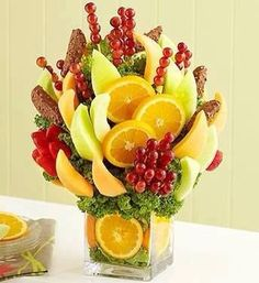 Fruit bouquet: you'll need a vase, skewers, and some greenery (Boston lettuce).