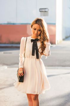 This white pastel bow dress office outfit is really trendy for this fall with its cinched waist!