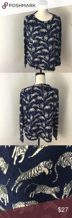 H&M Long Sleeve Tiger Top Size L H&M Long Sleeve Tiger Top Size L. Has a zipper on the back. Good condition. No trades. H&M Tops