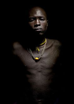 Surma warrior with scarifications - Ethiopia