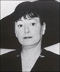 1940s VISAGE  Someone sent me this photo of Dorothy Parker, it is undated. She has little aviator wings on her dress, maybe because her husband was in the Army Air Corps?