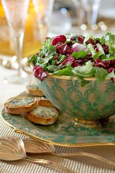 Salad features pomegranate seeds and dried cranberries with gorgonzola croutons served alongside.
