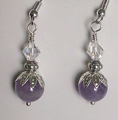 Gorgeous Amethyst purple genuine gemstone earrings made using: -10mm amethyst -6mm white Swarovski -7mm Sterling Silver bead -Sterling silver hook and caps http://www.luzjewelrydesign.com/collections/