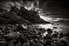 Dunluce Castle is a now-ruined medieval castle in Northern Ireland. It is located on the edge of a basalt outcropping in County Antrim