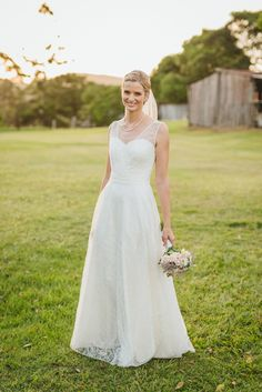 One of our real brides Penny looking amazing in our Kate gown with a V neck and 1/2 c/c skirt. Just stunning. From Bertossi Brides at Paddington weddings. www.paddingtonweddings.com.au