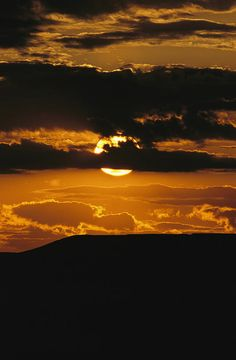 * The sun sets over 70 Mile Butte in Grasslands National Park - Saskatchewan, Canada