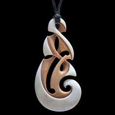New Life Koru pendant with wooden gift box carved in natural unbleached bone and stained by New Zealand Maori artist Kerry Thompson