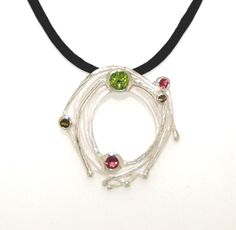Sterling silver, tourmaline and peridot twiggy pendant with black silk    $279    www.randbsutherland.com.au  #sterlingsilver #peridot #tourmaline #twig #nature #pendant #jewellery #randbsutherland #clarevalley