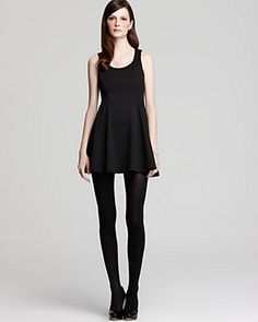 Simple black dress on a skinny girl.  Ahh to be able to wear this.