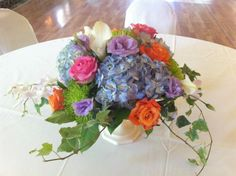 Lovely mix of colors and flower styles in this centerpiece.