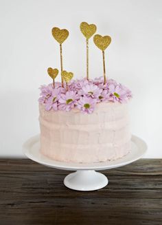 #poppiesforgrace glitter heart stickers atop Sara's coconut cake with strawberry cream