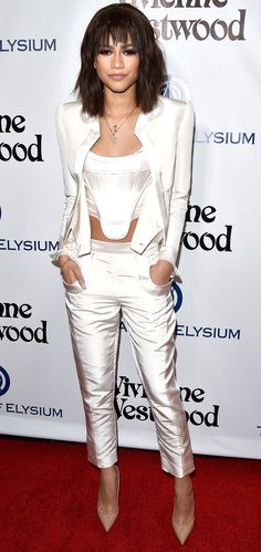 ZENDAYA in a Vivienne Wood bustier and a cool-girl white pantsuit, a banged bob, and nude heels