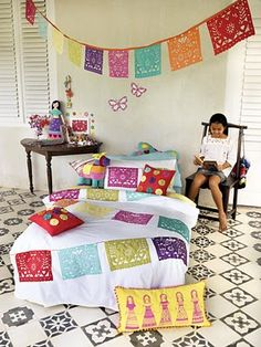 These traditional flags would make great bursts of color in a baby's nursery.   Very fun space.