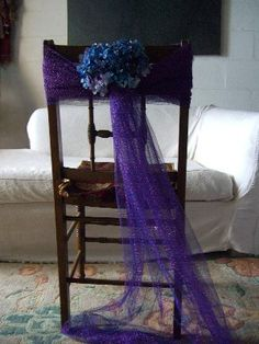 Love it, Tulle chair tie backs an inexpensive way to decorate for your wedding