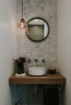 Maria opens the doors to her luxurious and contemporary home Stunning powder room with marble hexagon wall tiles, round mirror and copper pendant light As seen on season 1 of Decor Ideas That Make√ Small Bathroom Remo The Doors, Bad Inspiration, Bathroom Inspiration, Bathroom Ideas, Bathroom Remodeling, Light Bathroom, Remodeling Ideas, Bathroom Lighting, Bathroom Designs
