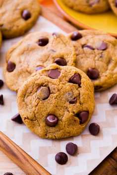 These CHEWY pumpkin chocolate chip cookies are a must try this fall! Recipe on sallysbakingaddiction.com