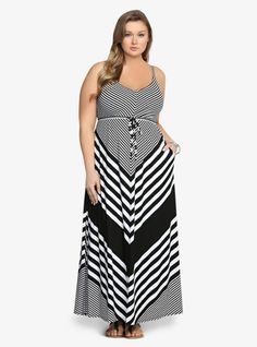 OMG, this dress knows how to pull off a gorgeous striped statement! This black and white maxi mixes up the pattern in a way that you're going to love. It's a soft, long look with casual side pockets and a drawstring waist that brings a flattering appeal to this flowy style.