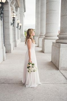 Light and airy bridals at Utah state capital building. A fabulous bride in that romantic flowing gown. #phancyphotography #bridal #Utah #Utahstatecapital #lightandairy #romantic #wedding #weddingphotographer #utahphotographer #rain