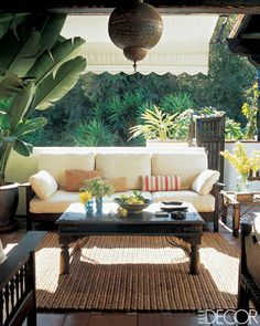 The terrace of Ben Stiller and Christine Taylor's Hollywood Hills home exudes an exotic vibe with Mission-influenced furniture and a light fixture from Morocco.