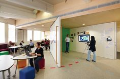 Swingable whiteboards and greenscreen! from architecture.au