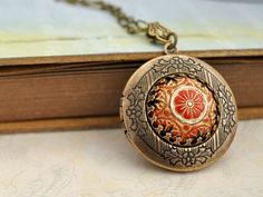 with my coral maxi. THE RUSSIAN PRINCESS hand painted pressed glass cab locket necklace in antiqued brass