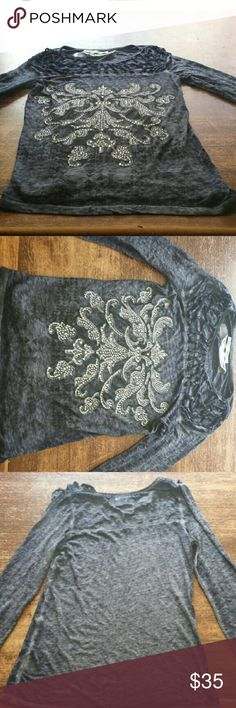 Long sleeve embellished Tee Brand new without tags. NEVER worn.  Dk. Wash Navy blue, long sleeve, cage neck embellished tee. Was received as a gift for Christmas. maurices Tops