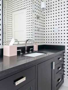 This black and white bathroom is part of the Garnet Residence by Laura U Interior Design. Showcasing an amazing design and color contrast, this rich bathroom stands on its own.