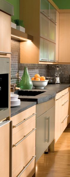 Soapstone countertop Why I like this: Clean cabinetry lines. Bright Contemporary Kitchen Design - Dura Supreme Cabinetry