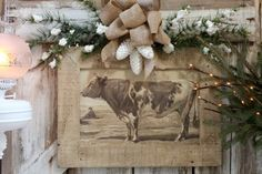 Cow in barnyard Christmas decor (from Sugar Pie Farmhouse)