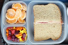 Clementine wedges, goldfish crackers and a homemade blackberry jam sandwich. Packed in an #EasyLunchbox