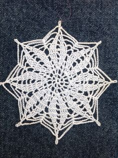 Crochet snowflake: old Anna magazine pattern.By Debbie Irving