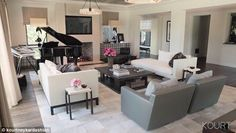 Major overhaul: Kourtney Kardashian shared the finished results of a total home design makeover via her website www.kourtneykardashian.com on Tuesday that included a look at her plush living room