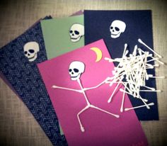 Skull Art Halloween Party Craft - perfect for young children to make at their class party! The link will take you to a free skull template to print at home so all you will need is craft paper, glue and cotton swabs.