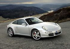 997 Carrera 2S: Underated and generally misunderstood. Can do fast road trips, be accpetable on the circuit and never misses a beat. Why would i sell it?!?