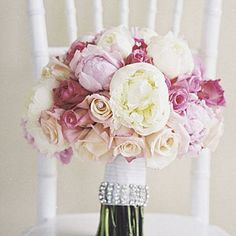 Glam and Girly Bouquet | A rhinestone cuff is the perfect accent to this feminine clutch of pink roses and peonies. | SouthernLiving.com