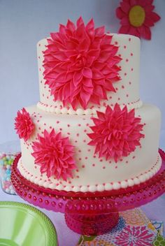 "Gorgeous!!  Cake is 9"" and 6"" with hot pink gumpaste dahlias in different sizes"