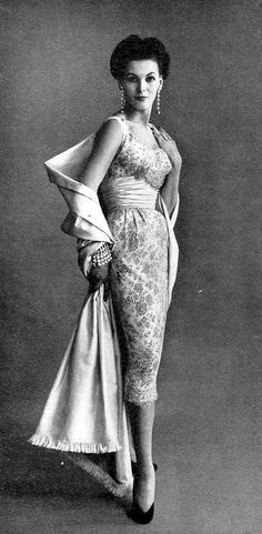 1953 Georgia Hamilton in embroidered cocktail dress with satin cummerbund and matching satin stole by Harmay, Vogue, December