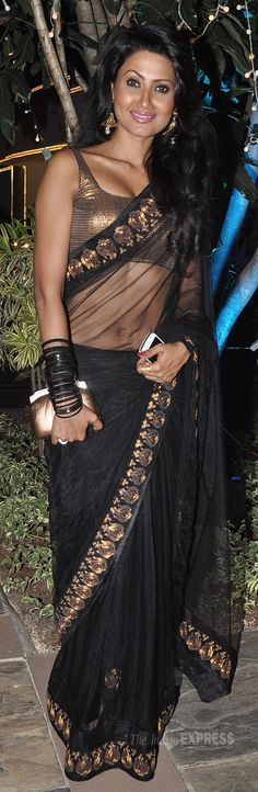 Nigaar Khan in a black and gold saree at a 2013 Diwali Party (IE Photo: Varinder Chawla) #saree #indian wedding #fashion #style #bride #bridal party #brides maids #gorgeous #sexy #vibrant #elegant #blouse #choli #jewelry #bangles #lehenga #desi style #shaadi #designer #outfit #inspired #beautiful #must-have's #india #bollywood #south asain