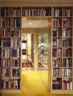 Surrounding the doorway between rooms with shelves. Makes the door look like it is carved through the book wall. Awesome.