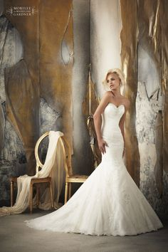 mori lee 1916 This Fishtail silhouette Wedding dress has Beaded Alencon Lace Appliques on Soft Net over Chantilly Lace under layer with a corset tie back.