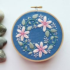 Check out this item in my Etsy shop https://www.etsy.com/listing/290279269/hand-embroidered-mini-floral-wreath-5