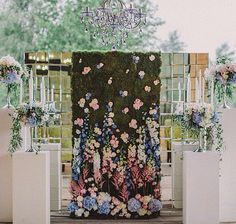 Elaborate floral, moss and mirrors ceremony backdrop